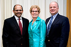 ONPHA Executive Director and President with Minister Kathleen Wynne